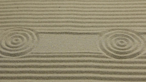 Circles and lines on the sand. Slider shot. Texture of sand. Top view Live Action