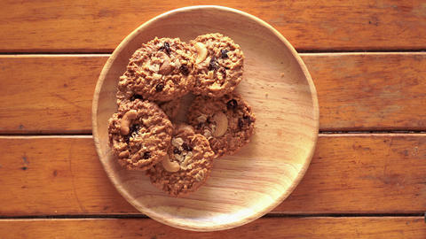 Stop Motion, the cookies that are on the plate disappear one by one Live Action