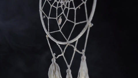 Mystical attribute dreamcatcher on a black background with smoke Live Action