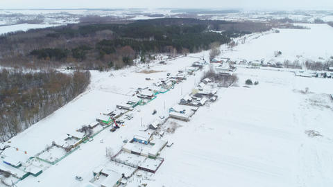 village covered with snow and electricians brigade aerial Live Action