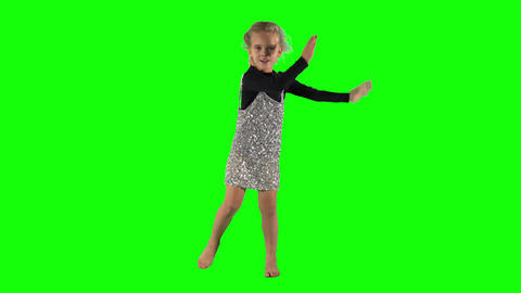 Adorable little girl swinging in tact over chroma key green background Live Action