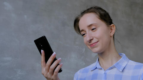 Woman using smartphone, having video chat, job interview or distant consultation Live Action