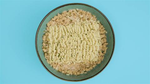 Preparing a quick noodles pasta in blue bowl, timelapse, top view Live Action