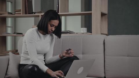 Black Woman Making Online Transaction On Sofa Live Action