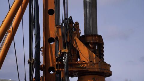 Drilling machine doing job with sky background. close up Live Action