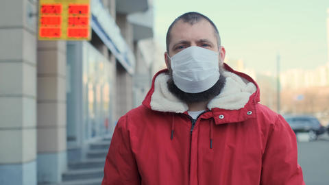 World crisis 2020. Man looks at currency exchange display. Pandemic disease Live Action