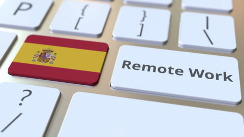Remote Work text and flag of Spain on the computer keyboard. Telecommuting or Live Action