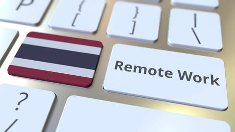 Remote Work text and flag of Thailand on the computer keyboard. Telecommuting or Live Action