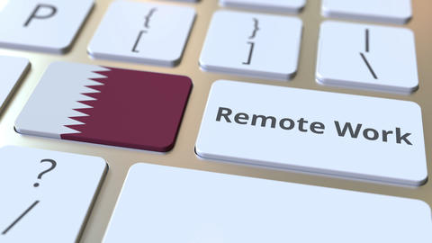 Remote Work text and flag of Qatar on the computer keyboard. Telecommuting or ライブ動画
