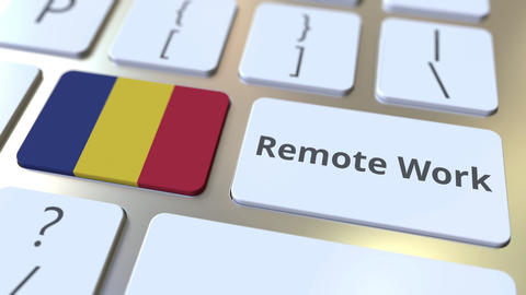 Remote Work text and flag of Romania on the computer keyboard. Telecommuting or Live Action