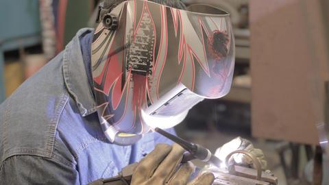 Industrial Worker Welding American Steel Worker Dolly Shot in 4K 60 Fps Live Action