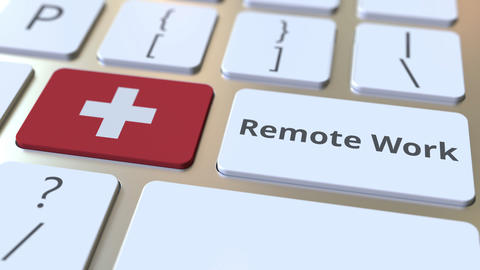 Remote Work text and flag of Switzerland on the computer keyboard. Telecommuting Live Action