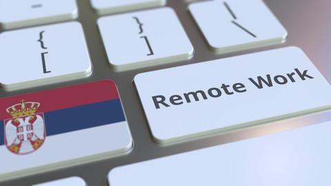 Remote Work text and flag of Serbia on the computer keyboard. Telecommuting or Live Action
