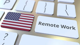 Remote Work text and flag of the USA on the computer keyboard. Telecommuting or Live Action