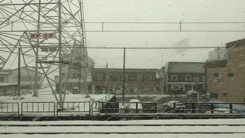Winter cityscape. Japan Railway train window Live Action