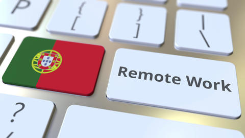 Remote Work text and flag of Portugal on the computer keyboard. Telecommuting or Live Action