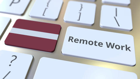 Remote Work text and flag of Latvia on the computer keyboard. Telecommuting or ライブ動画