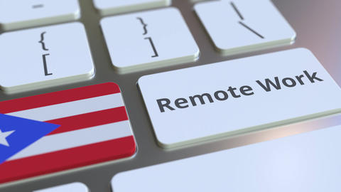 Remote Work text and flag of Puerto Rico on the computer keyboard. Telecommuting ライブ動画