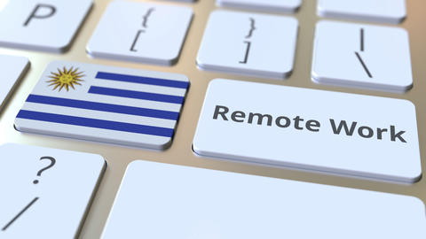 Remote Work text and flag of Uruguay on the computer keyboard. Telecommuting or ライブ動画