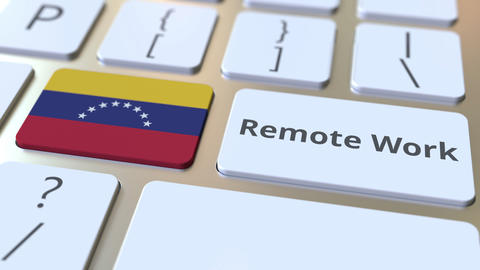 Remote Work text and flag of Venezuela on the computer keyboard. Telecommuting Live Action