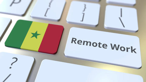 Remote Work text and flag of Senegal on the computer keyboard. Telecommuting or Live Action