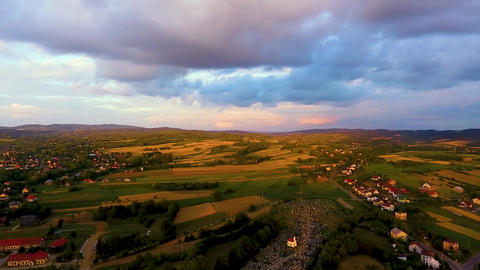 Aerial view of colourful fields and sunset, colorful sunset Live Action