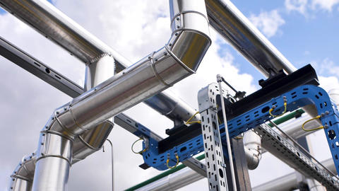 Steel pipes against the sky, reflection of light, blue sky and clouds Live Action