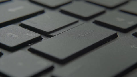 The finger presses the Enter button on the keyboard Live-Action