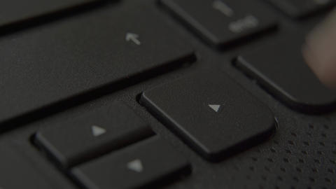 Finger presses the right button on the keyboard Live-Action
