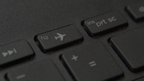 """The finger presses the """"Airplane"""" button on the keyboard Live-Action"""