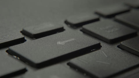 The finger presses the backspace button on the keyboard Live-Action