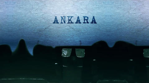 ANKARA words Typing on a sheet of paper with an old vintage typewriter Live-Action
