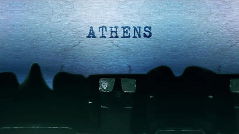 ATHENS words Typing on a sheet of paper with an old vintage typewriter Live-Action