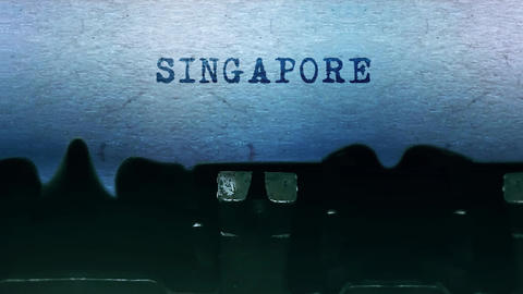 Singapor words Typing on a sheet of paper with an old vintage typewriter Live-Action