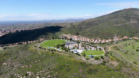 Aerial view of small community park in middle class neighborhood in the valley Live-Action