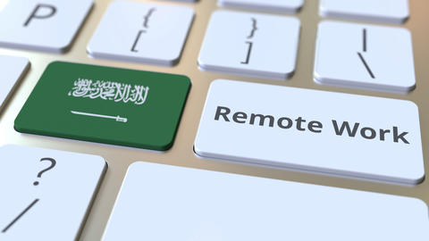 Remote Work text and flag of Saudi Arabia on the computer keyboard Live-Action