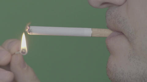 Cigarette in the mouth of a smoker. Close-up. Slow motion Live Action