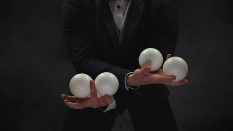Closeup of man juggling balls. Concept of success, business and managing Live Action