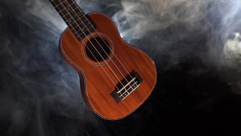 Red wood Hawaii ukulele guitar isolated against black background with smoke Live Action