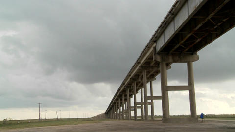 A time lapse shot of a raised bridge as a storm approaches Stock Video Footage