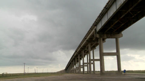 A time lapse shot of a raised bridge as a storm approaches Footage
