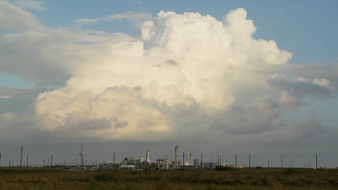 Beautiful time lapse of clouds over an oil refinery Stock Video Footage
