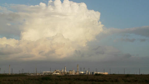 Beautiful time lapse of clouds over an oil refinery Footage