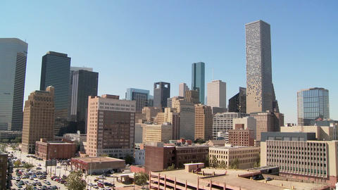 Whip zoom out from Houston skyline on a bright sunny day Stock Video Footage