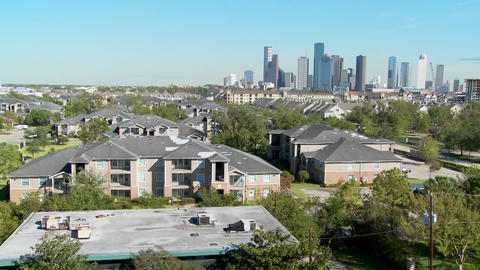 A pan across a suburban area of Houston with the downtown distant Footage