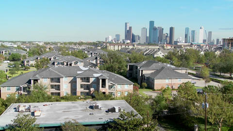 A pan across a suburban area of Houston with the downtown... Stock Video Footage