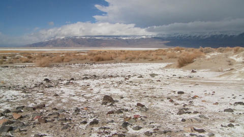 Time lapse of clouds over the Owens Valley dry lake bed Stock Video Footage