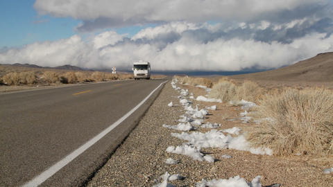 A motor home passes on a remote desert road Stock Video Footage
