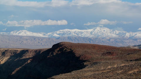 Time lapse of clouds moving over Death Valley mountains Stock Video Footage
