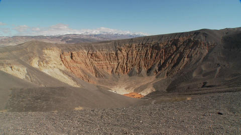 Pan across a volcanic crater in Death Valley National Park Stock Video Footage